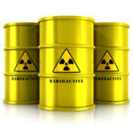 Creative abstract nucleat power fuel manufacturing, disposal and utilization industry concept: group of yellow metal barrels, drums or containers with poison dangerous hazardous radioactive materials isolated on white background with reflection effect